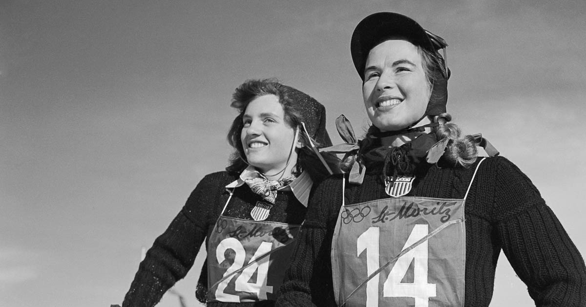 (Original Caption) Two of the U.S. team's women skiers flash winning smiles. Mrs. Gretchen Fraser (right), 28-year-old housewife from Vancouver, Washington, took first place in the women's special slalom event, becoming the first American ever to win an individual skiing championship in the history of the Olympic games. Andrea Mead (left) of Rutland, Vermont, placed eighth in the event.