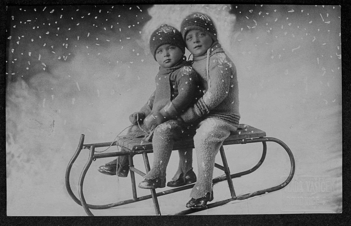 Two young children play on a sled. | Location: Roudnice, Czech Lands. (Photo by V. Vasicek/Scheufler Collection/Corbis/VCG via Getty Images)